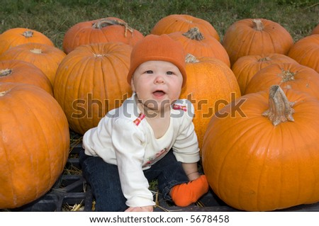 Baby Girl in Pumpkin Patch