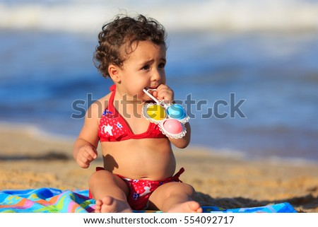 Baby Girl on the beach seated