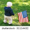 baby-girl with American flag - stock photo