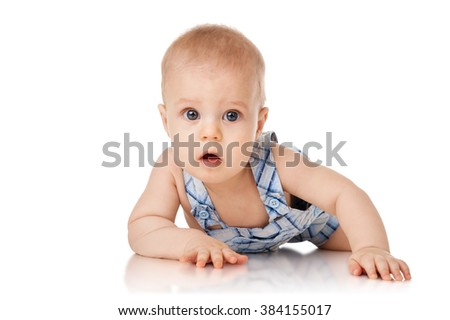 Baby is lying on floor, isolated on white