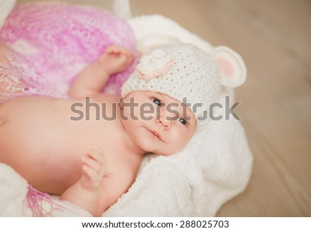 Baby newborn child sleep in basket cute little girl new born baby smiling, portrait of 1 month baby girl, adorable kid in cozy accessories at home, soft focus, mother care concept, series