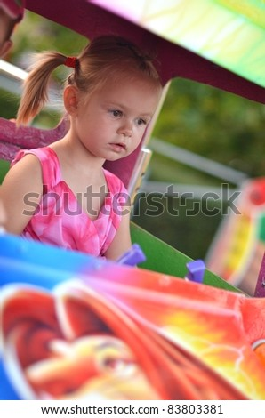baby on carousel