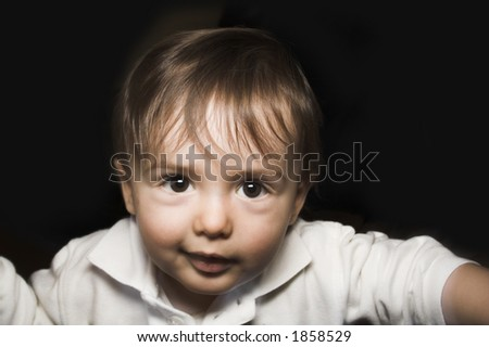 baby portrait over black background