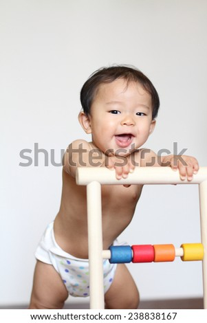 Baby pushing a cart (Japanese boy)