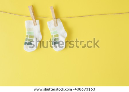 Baby socks hanging on the clothesline