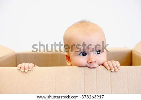 Baby toddler in a carton box dreaming