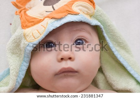 baby wrapped in a towel after a swim