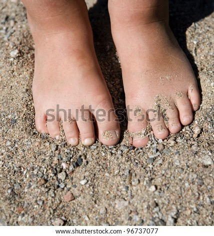 Babys feet in the sand
