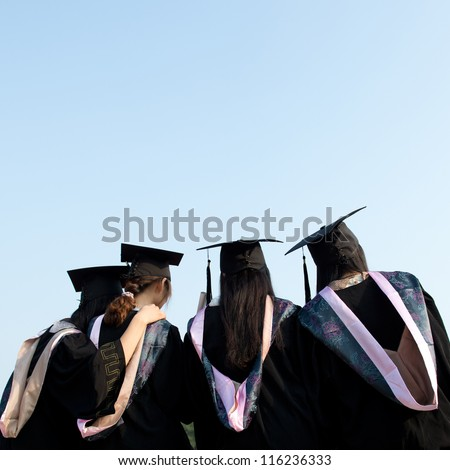 back of graduates together with the blue sky.