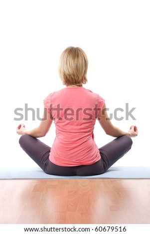 Back of relaxing Young woman practise yoga
