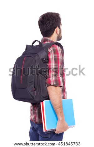Back view of a male student standing with backpack and notebooks, isolated on white background