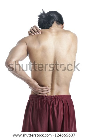 Back view of a man suffering from lower back pain standing on a white surface