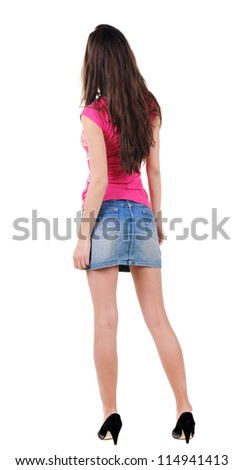 Back view of beautiful young woman looking at wall. Rear view people collection.  backside view of person.  Isolated over white background.