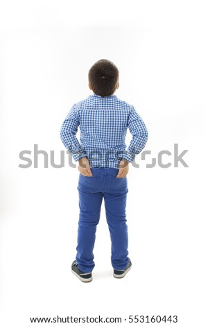 Back view of little boy looking at wall. Rear view. Isolated on white background