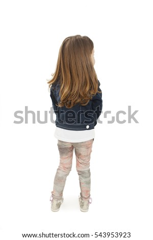 Back view of little girl looking on side. Isolated on white background