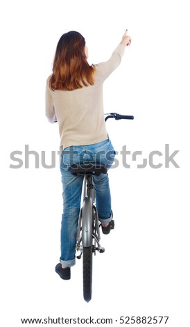 back view of pointing woman with a bicycle. cyclist sits on the bike. Rear view people collection.  backside view of person. Isolated over white background. Girl on bike rides pointing where to go.