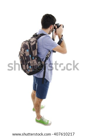 Back view of tourist photographer man taking picture. Isolated on white background