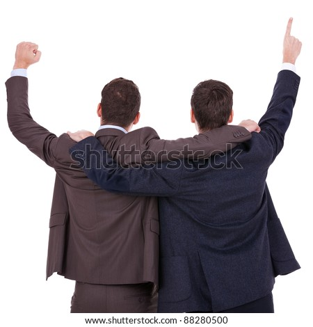back view of two winning businessmen with their hands in the air over white background