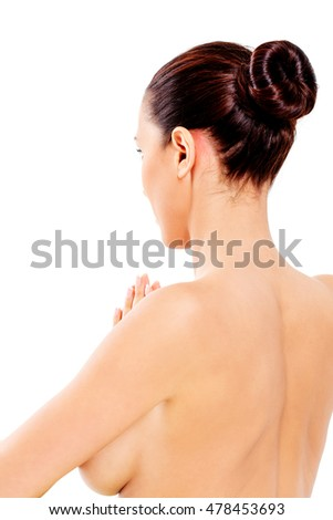 Back view of woman in towel sitting on the floor