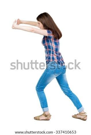 back view of woman pushes wall. Isolated over white background. Rear view people collection. backside view of person.