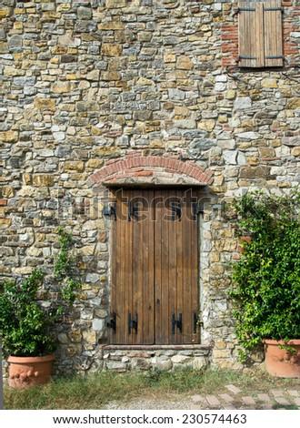tuscan wooden doors old wooden door stone wall stock photo 529056373 shutterstock