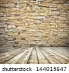 Background of aged grungy textured brown brick and stone wall with light wooden floor with whiteboard inside old neglected and deserted empty interior, blank horizontal space of clean studio room - stock photo