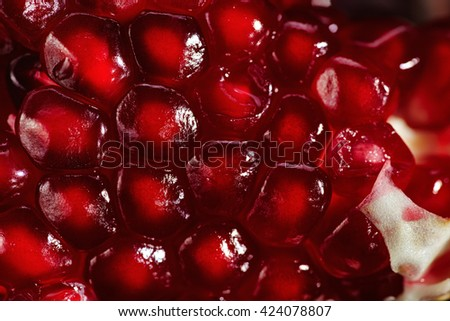 background of pomegranate seeds, close-up