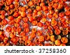 Background of rotten tomatoes - organic waste - stock photo
