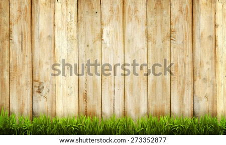 Background of wooden fence and green grass
