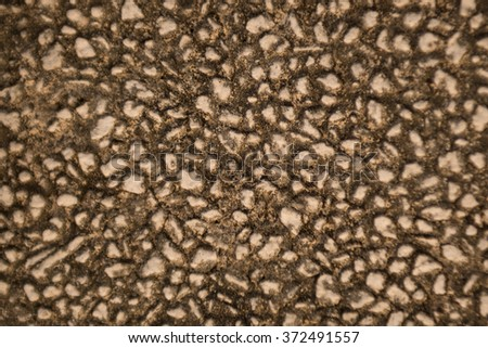 Background texture of old stone wall , focus center