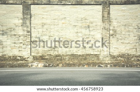 Background wall made of bricks. The ground floor streets. Vintage style.