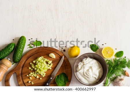 Background with the ingredients  for cooking tzatziki sauce