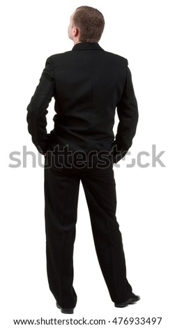 backside view of person. back view of Businessman looks ahead. Young guy in black suit  watching.  Rear view people collection.    Isolated over white background