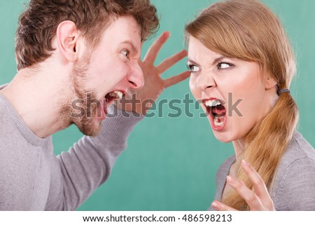 Bad relationship and divorce. Expressive young couple yelling shouting. Husband and wife having big emotional argue split quarrel.