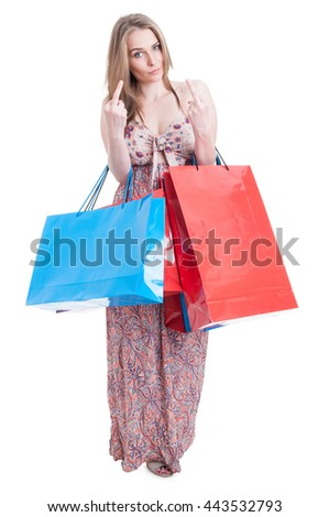 Bad shopper female with gift bags doing double obscene gesture by showing both middle fingers isolated on white with copyspace