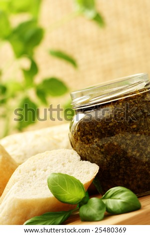 baguette and jar of pesto - delicious snack - food and drink
