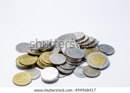 Baht Thailand coins pile of money on a white background.