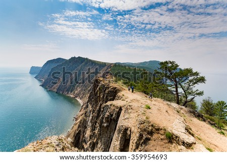 Baikal, Russia - July 24, 2015: a tour group enjoying the views from the northernmost Cape of Olkhon island, Cape Khoboy.