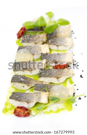 baked black cod fish on a white background in the restaurant