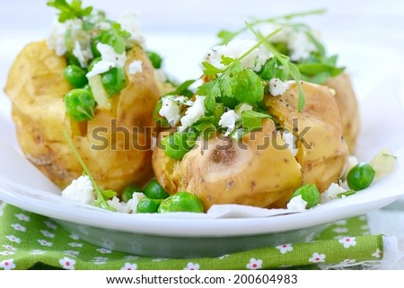 baked potato stuffed with green peas and feta  cheese .selective focus