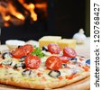 baked tasty pizza  near wood oven - stock photo