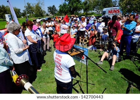 BAKERSFIELD, CA-JUN 15: Dolores Huerta inspires the crowd before the march to Congressman Kevin McCarthy's office in support of a new immigration law on June 15, 2013, in Bakersfield, California.