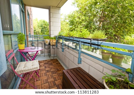 Balcony Of Condo With Patio Furniture And Plants