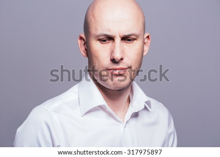 bald young man portrait close-up