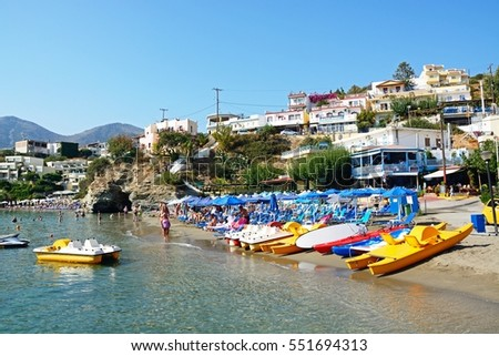 BALI, CRETE - SEPTEMBER 16, 2016 - Tourists relaxing on the beach with town buildings to the rear, Bali, Crete, Greece, Europe, September 16, 2016.