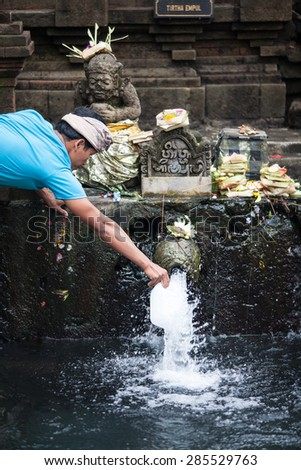 BALI, INDONESIA - MAY 29: Unidentified hinduism people washing at holy spring pool in Tirta Empul Temple, It's famous for holy water where Hindu people go for purification in Bali on May 29, 2015.