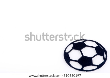 Ball made from carpet fabric over white background