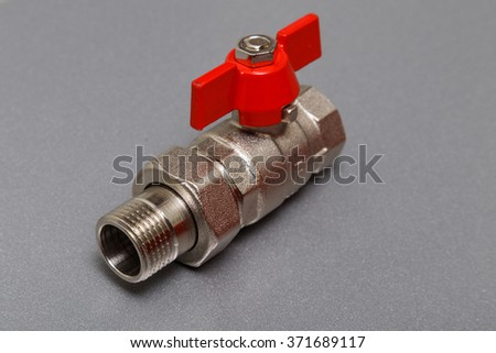 Ball valve with blue handles on a white background