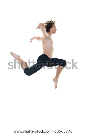 ballet dancer practicing high jumps over white background