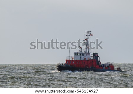 BALTIC SEA, POMERANIAN BAY / POLAND - JULY, 2016: Fireboat flows on the Baltic Sea